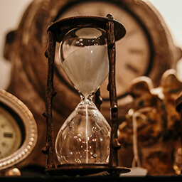 A classical hourglass demonstrates the passage of time.