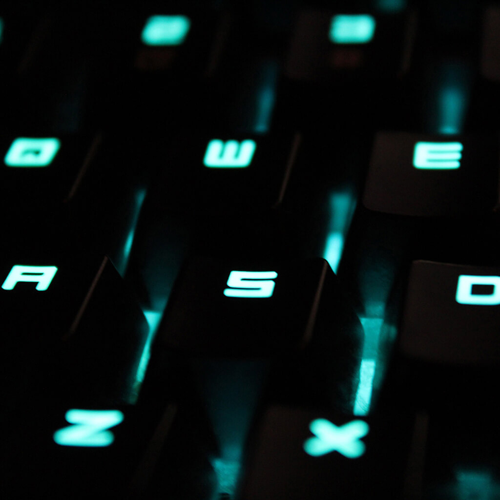 A gaming laptop with lit keys.