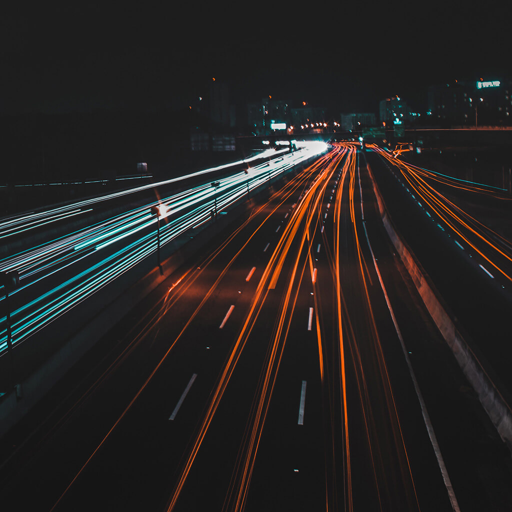Cars racing through the night.